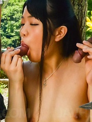 Misaki Oosawa Asian sucks two tools and has tits exposed in park