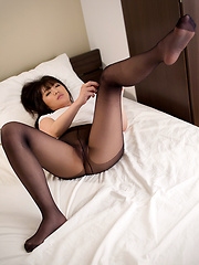 Shiina Mizuho posing in broken pantyhose
