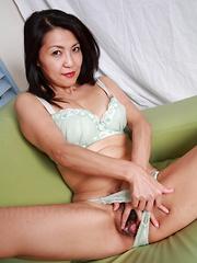 Japanese MILF lady teasing her lovely cunt