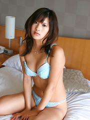 Sara Tsukigami Asian undresses and sits in naughty positions